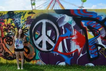 Jasmine with the graffiti wall